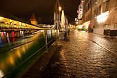Night Time Scene Of European City Along River