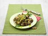 stock photo of leek  - stew meat with leek and pine nuts - JPG