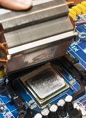 foto of cpu  - close up on broken cpu on motherboard - JPG