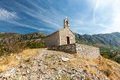 stock photo of chapels  - The old medieval chapel in mountains - JPG