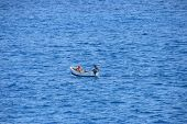 picture of lobster boat  - Fishing boat alone in the middle of the ocean - JPG
