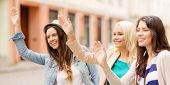 picture of waving hands  - holidays and tourism concept  - JPG