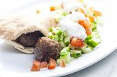 stock photo of pita  - meatball in pan pita with tomato and cucumber salad - JPG