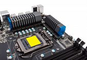 foto of processor socket  - Multiphase power system modern processor with heatsink and the CPU socket - JPG