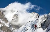image of nepali  - group of climbers on mountains montage to mount Lhotse Everest area Khumbu valley Nepal - JPG