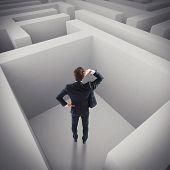 foto of interrogation  - Businessman in trouble lost in a maze - JPG
