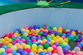 stock photo of pool ball  - colorful plastic ball floating on water in the pool for games - JPG