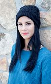 picture of piercings  - Pretty brunette girl with wool cap and piercing - JPG