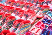 stock photo of shoes colorful  - blurry defocused image of colorful handmade fabric kid shoe of tribesman in northern part of thailand for background - JPG