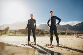 picture of triathlon  - Portrait of a determined male and female triathletes looking into the distance - JPG