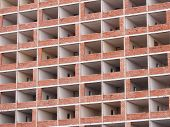 foto of high-rise  - Deserted and completely gutted flats in a high rise building made of concrete and bricks - JPG