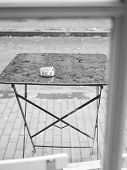 image of ashes  - Empty outdoor table with ash tray in a coffee shop in Amsterdam - JPG