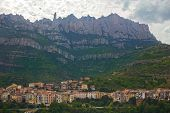 stock photo of old spanish trail  - Monistrol de Montserrat - a town at the bottom of the Montserrat Mountain, Catalonia, Spain