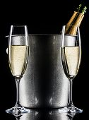 foto of flute  - Champagne bottle inside ice bucket and two champagne flutes - JPG