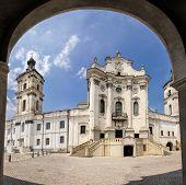 stock photo of carmelite  - View of the Mariinsky catholic church through the arch of the main entrance - JPG