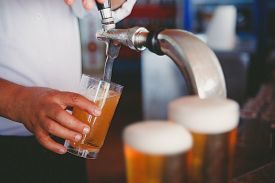 foto of draft  - Draft beer pour in a glass from the crane - JPG