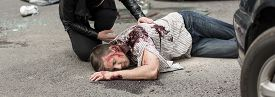 picture of street-walker  - Unconscious young man is lying on street - JPG