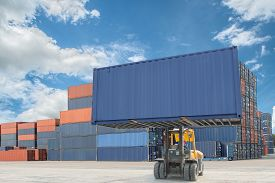 stock photo of forklift  - forklift handling container box loading to truck in import export logistic zone - JPG