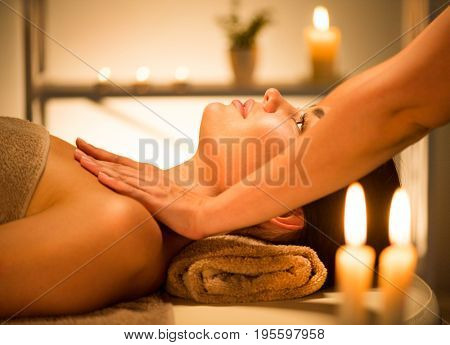 poster of Spa woman Massage. Face Massage in beauty spa salon. Female enjoying relaxing body  massage in spa c
