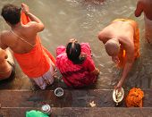 VARANASI, INDIA - NOVEMBER 6: Unidentified people wash themselves in the river Ganga on Nov. 6, 2010