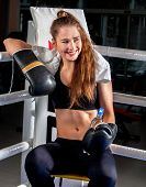 Boxing woman workout in fitness class. Boxer wearing gloves to box and tower in ring. Girl sitting i poster