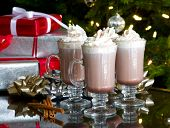 christmas relaxation:  cups of hot chocolate and whipped cream with holiday background