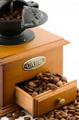 picture of wooden box from coffee mill  - wooden coffee grinder with beans on white - JPG
