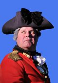 foto of revolutionary war  - Man in British military dress at Revolutionary War Re - JPG