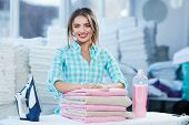 Woman Leaning On Heap Of Rose Towels poster