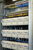 stock photo of busbar  - New control panel with static energy meters - JPG