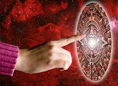 hand touching a Maya stone calendar in space