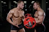 Two Brutal Strong Athletic Men Pumping Up Muscles And Train In Gym Workout poster