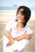 Happy woman portrait On The Beach