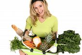 stock photo of fruits vegetables  - A woman with an eco shopping back filled with food essentials fresh fruit vegetables milk and bread - JPG
