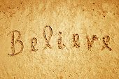 Believe handwritten in sand for natural, symbol,tourism,religion or conceptual designs