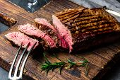 Sliced Grilled Medium Rare Beef Steak Served On Wooden Board Barbecue, Bbq Meat Beef Tenderloin. Top poster