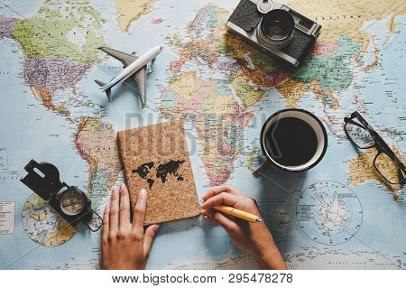poster of Top View Of Young Woman Planning Her Vacation Using World Map - Travel  Influencer Looking For The N