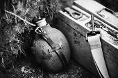 Old German Wehrmacht Times Of World War Ii Vintage Flask And Box Of Ammunition On Ground. Photo In B poster