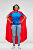 super power and people concept - happy african american young woman in superhero red cape over grey  poster