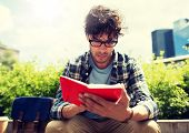 lifestyle, creativity, freelance, inspiration and people concept - creative man with notebook or dia poster