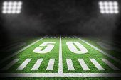 Close Up Of American Football Field With Stadium Spotlight On Specific 50 Yard Markings And Backgrou poster