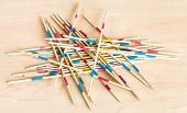 Pile From Wooden Sticks Of Mikado Pick-up Sticks Game On Wood Board poster
