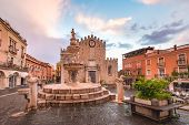 Cathedral Of Taormina And Fountain On The Square Piazza Duomo In Taormina At Rainy Night, Sicily, It poster