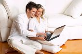 pic of love couple  - Young love couple smiling in the comfortable apartment - JPG