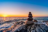 Zen stacked stones at the beach poster