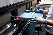Working Operator At A Manufacturing Plant Bending Sheet Metal On A Sheet Hydraulic Bending Machine poster