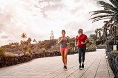 Happy Sporty Couple Running Outdoor - Fit Friends Jogging And Training Together  Outside - People, H poster