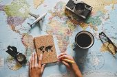 Top View Of Young Woman Planning Her Vacation Using World Map - Travel  Influencer Looking For The N poster