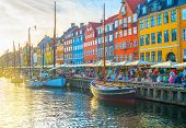 Nyhavn View With Boats By Embankment At Sunset, People, Motion Blur, Copenhagen, Denmark poster