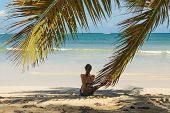 Traveler Girl Relaxing On Tropical Beach. Young Girl Traveler Relaxing In Vacation. Traveler Relaxin poster